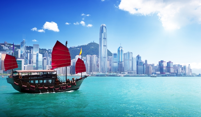 Come Away With Me: 2018 Travel Bucket List by Fashion Du Jour LDN. Daytime Hong Kong Skyline cityscape boat