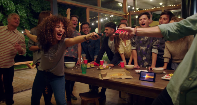NintenDON'T Miss Out!: How To Have Great Times With Friends by Fashion Du Jour LDN. People Playing Nintendo Switch at party