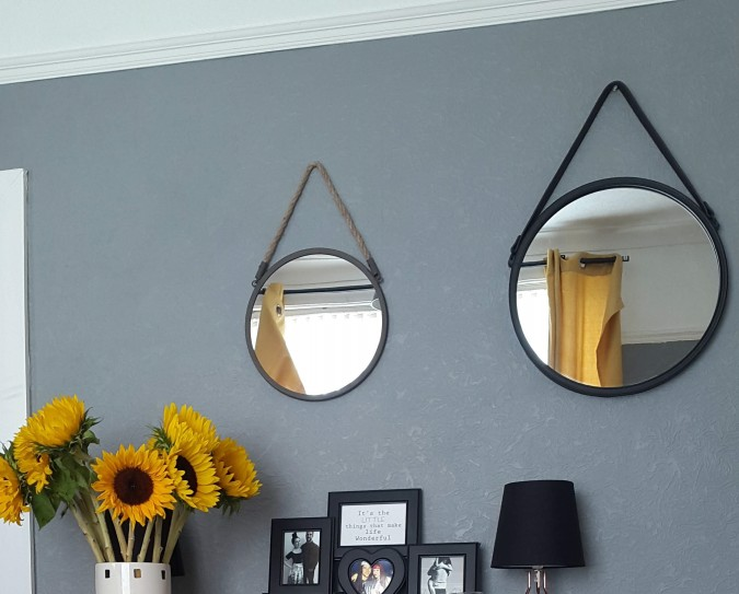 Feathering Your Nest How To Save Money In Your First Home by Fashion Du Jour LDN. Maison Du Monde round mirrors, sunflowers, black picture frames, rose gold lamps, grey paint