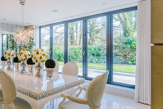Light and Shade - How To Make Impact In Your Home With Windows And Blinds by Fashion Du Jour LDN. Bi-folding dining room doors onto garden by Glow Glass