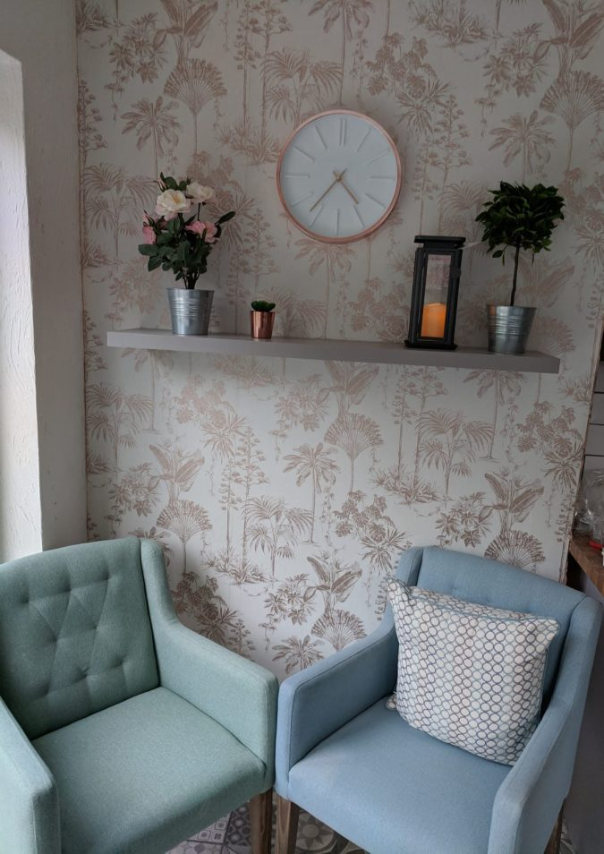 Feathering Your Nest How To Save Money In Your First Home by Fashion Du Jour LDN. Graham and Brown rose gold wallpaper, Rose gold George at asda clock, plants, rose gold accesories, next duck egg dining chairs