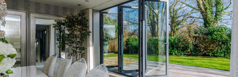 Light and Shade - How To Make Impact In Your Home With Windows And Blinds by Fashion Du Jour LDN. Bi-folding kitchen doors onto garden by Glow Glass