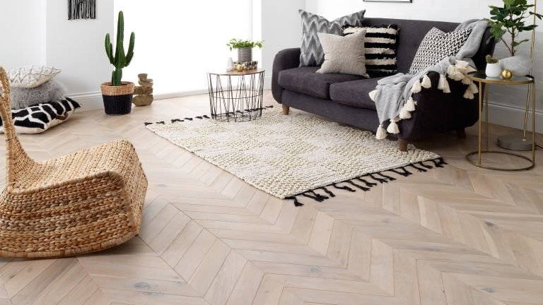 You get the look ofsolid wood, without the price. Grey parque engineered wood flooring. lounge