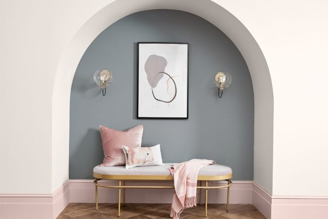 Sweet Dreams: Our 2020 Bedroom Interior Trend Predictions by Fashion Du Jour LDN. Close-up of grey and blush pink painted wall, grey and white abstract line drawing wall art,brushed chrome and glass wall light fittings, blush pink upholstered bed, teal velvet chaise lounge ottoman grey, white and blush pink bedroom interior