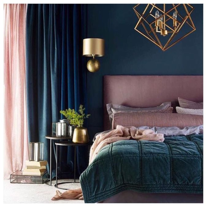 Sweet Dreams: Our 2020 Bedroom Interior Trend Predictions by Fashion Du Jour LDN. Close-up of teal painted wall, brushed chrome light fittings and lamps, blush pink upholstered bed, teal velvet throws, teal, navy and blush pink bedroom interior