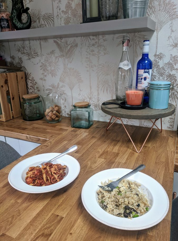 Small Prices Big Gains How Musclefood Can Transform Your Meal Time And You By Fashion Du Jour LDN. Wooden Breakfast Bar in grey kitchen. Green glass jars, copper gold accents, graham & brown copper wall paper. Two bowls of food. Musclefood Prepped Pots in Beef Ragu and Mushroom Risotto